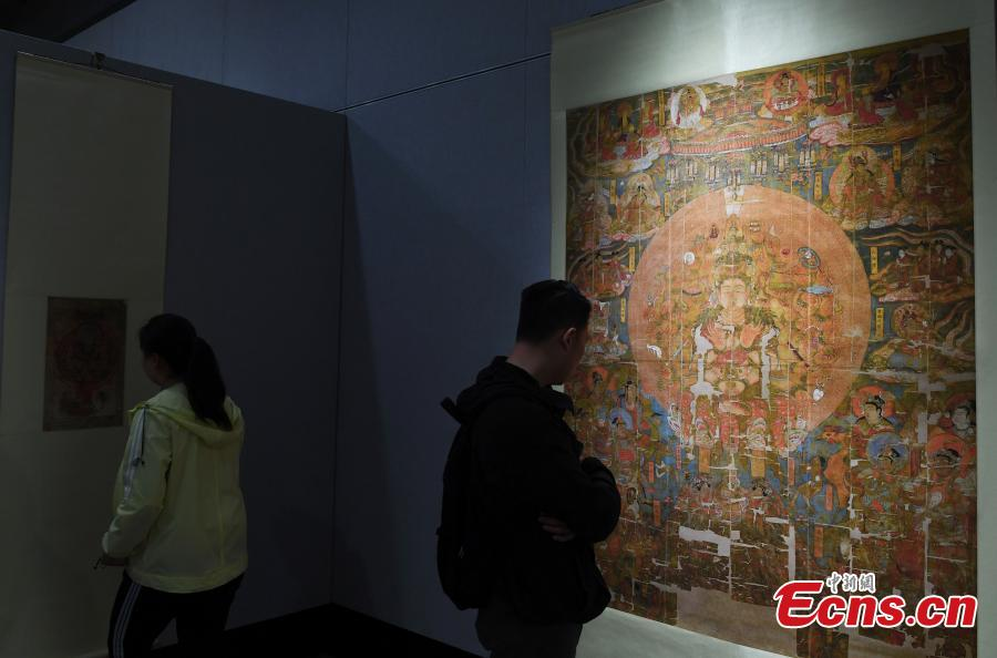 An exhibition featuring over 90 replicas of relics from Mogao Grottoes is underway at Northwest Normal University in Lanzhou City, Northwest China\'s Gansu Province, April 23, 2019. The life-size replicas are based on original murals or paintings from Mogao Grottoes, which are now collected in museums in the UK, France, the U.S., and Japan.  (Photo: China News Service/Yang Yanmin)