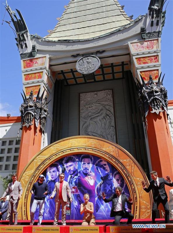 Actors Chris Hemsworth, Chris Evans, Robert Downey Jr., actress Scarlett Johansson, actors Mark Ruffalo, Jeremy Renner (From L to R) attend their print ceremony in the forecourt of the TCL Chinese Theater in Los Angeles, the United States, April 23, 2019. The cast of Marvel Studios \