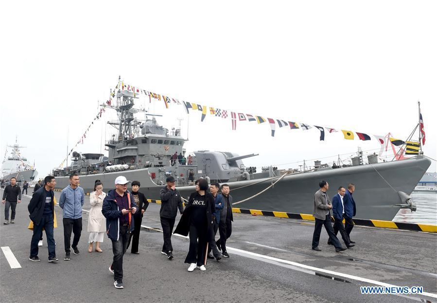 Visitors are seen during a warship open day event in Qingdao, east China\'s Shandong Province, April 24, 2019. A warship open day event was held on Wednesday in Qingdao, as part the multinational naval events marking the 70th founding anniversary of PLA Navy. (Xinhua/Ma Jing)