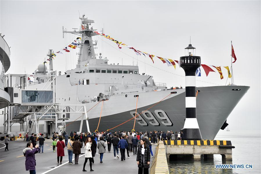 Visitors view the landing vessel Jinggangshan of the Chinese People\'s Liberation Army (PLA) Navy during a warship open day event in Qingdao, east China\'s Shandong Province, April 24, 2019. A warship open day event was held on Wednesday in Qingdao, as part the multinational naval events marking the 70th founding anniversary of PLA Navy. (Xinhua/Guo Xulei)