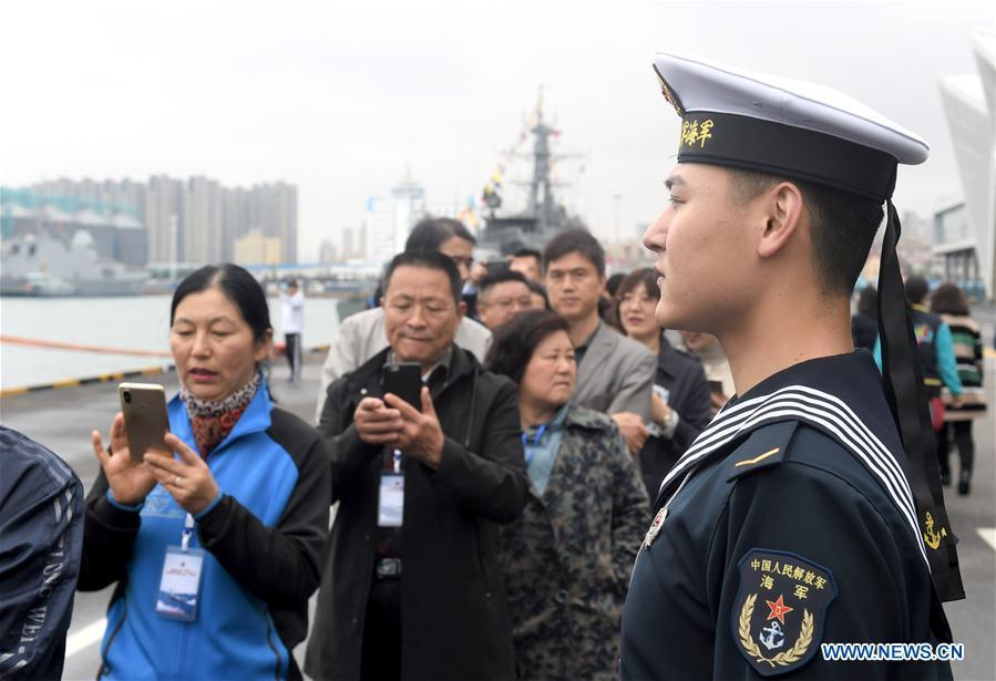 Visitors prepare to board guided-missile destroyer Guiyang of the Chinese People\'s Liberation Army (PLA) Navy during a warship open day event in Qingdao, east China\'s Shandong Province, April 24, 2019. A warship open day event was held on Wednesday in Qingdao, as part the multinational naval events marking the 70th founding anniversary of PLA Navy. (Xinhua/Ma Jing)