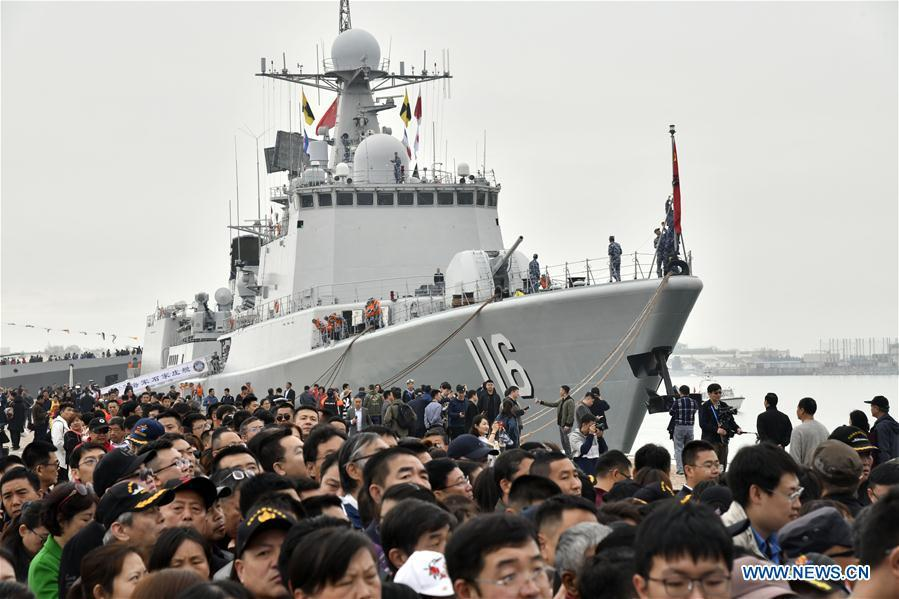 Visitors are seen during a warship open day event in Qingdao, east China\'s Shandong Province, April 24, 2019. A warship open day event was held on Wednesday in Qingdao, as part the multinational naval events marking the 70th founding anniversary of PLA Navy. (Xinhua/Guo Xulei)