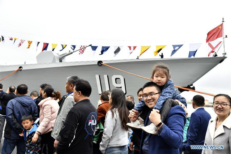 Visitors view the guided-missile destroyer Guiyang of the Chinese People\'s Liberation Army (PLA) Navy during a warship open day event in Qingdao, east China\'s Shandong Province, April 24, 2019. A warship open day event was held on Wednesday in Qingdao, as part the multinational naval events marking the 70th founding anniversary of PLA Navy. (Xinhua/Guo Xulei)