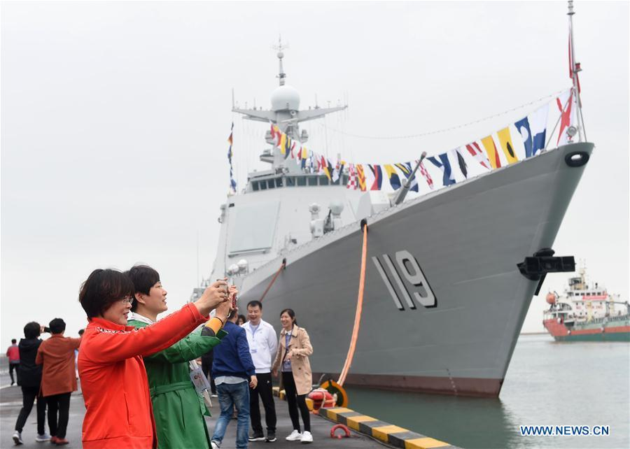 Visitors take photos of the guided-missile destroyer Guiyang of the Chinese People\'s Liberation Army (PLA) Navy during a warship open day event in Qingdao, east China\'s Shandong Province, April 24, 2019. A warship open day event was held on Wednesday in Qingdao, as part the multinational naval events marking the 70th founding anniversary of PLA Navy. (Xinhua/Wang Siwei)