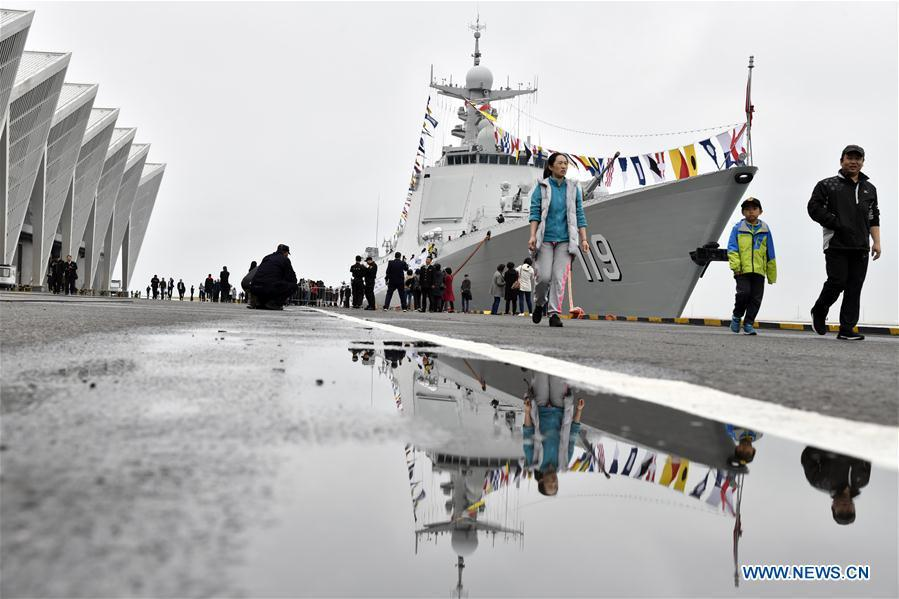 Visitors view the guided-missile destroyer Guiyang of the Chinese People\'s Liberation Army (PLA) Navy during a warship open day event in Qingdao, east China\'s Shandong Province, April 24, 2019. A warship open day event was held on Wednesday in Qingdao, as part the multinational naval events marking the 70th founding anniversary of PLA Navy. (Xinhua/Qian Yi)