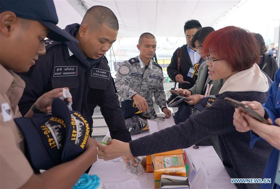 Visitors purchase souvenirs on Royal Thai Navy frigate HTMS Bangpakong during a warship open day event in Qingdao, east China\'s Shandong Province, April 24, 2019. A warship open day event was held on Wednesday in Qingdao, as part the multinational naval events marking the 70th founding anniversary of PLA Navy. (Xinhua/Wang Yuguo)