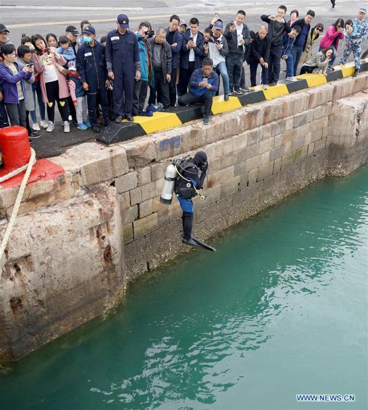 A Thai frogman jumps into water during a warship open day event in Qingdao, east China\'s Shandong Province, April 24, 2019. A warship open day event was held on Wednesday in Qingdao, as part the multinational naval events marking the 70th founding anniversary of PLA Navy. (Xinhua/Wang Yuguo)
