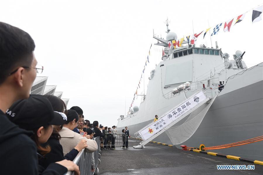 Visitors prepare to board on the guided-missile destroyer Guiyang of the Chinese People\'s Liberation Army (PLA) Navy during a warship open day event in Qingdao, east China\'s Shandong Province, April 24, 2019. A warship open day event was held on Wednesday in Qingdao, as part the multinational naval events marking the 70th founding anniversary of PLA Navy. (Xinhua/Luo Xiaoguang)