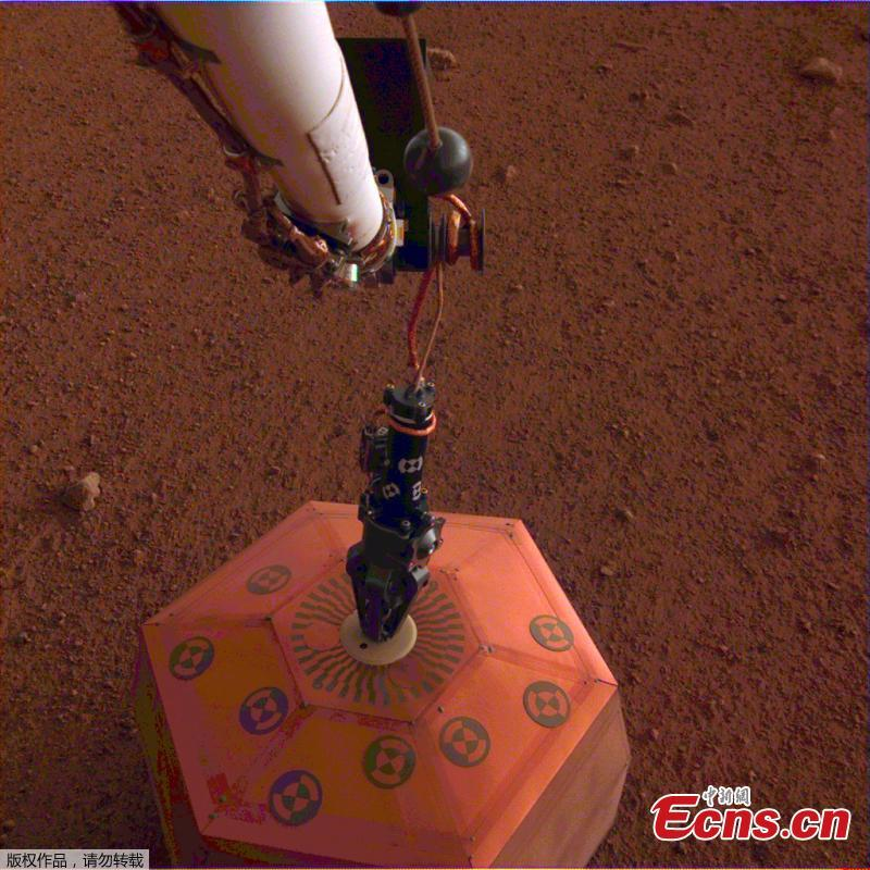 NASA\'s InSight lander set its heat probe, called the Heat and Physical Properties Package (HP3), on the Martian surface on Feb. 12, 2019.  (Photo/NASA)