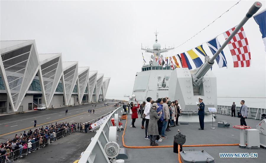 Visitors stand on guided-missile destroyer Guiyang of the Chinese People\'s Liberation Army (PLA) Navy during a warship open day event in Qingdao, east China\'s Shandong Province, April 24, 2019. A warship open day event was held on Wednesday in Qingdao, as part the multinational naval events marking the 70th founding anniversary of PLA Navy. (Xinhua/Wang Yuguo)