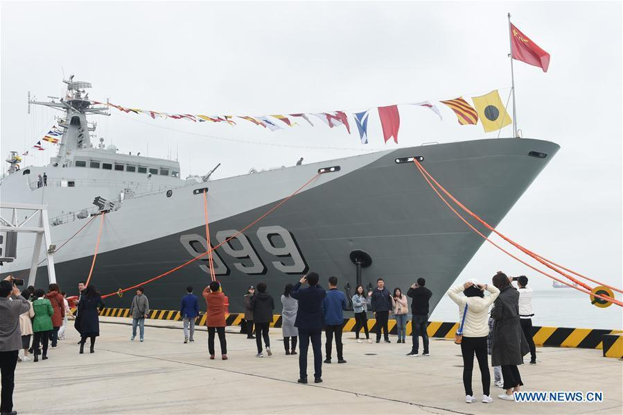 Visitors take photos during a warship open day event in Qingdao, east China\'s Shandong Province, April 24, 2019. A warship open day event was held on Wednesday in Qingdao, as part the multinational naval events marking the 70th founding anniversary of PLA Navy. (Xinhua/Luo Xiaoguang)