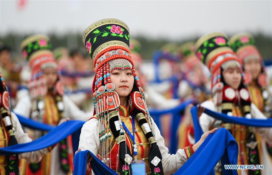 People dressed in traditional costumes perform at the Genghis Khan Chagan Suluk Nadam Fair in Ejin Horo Banner of Ordos City, north China\'s Inner Mongolia Autonomous Region, April 24, 2019. The two-day fair kicked off on Wednesday, including a variety of traditional activities. (Xinhua/Peng Yuan)