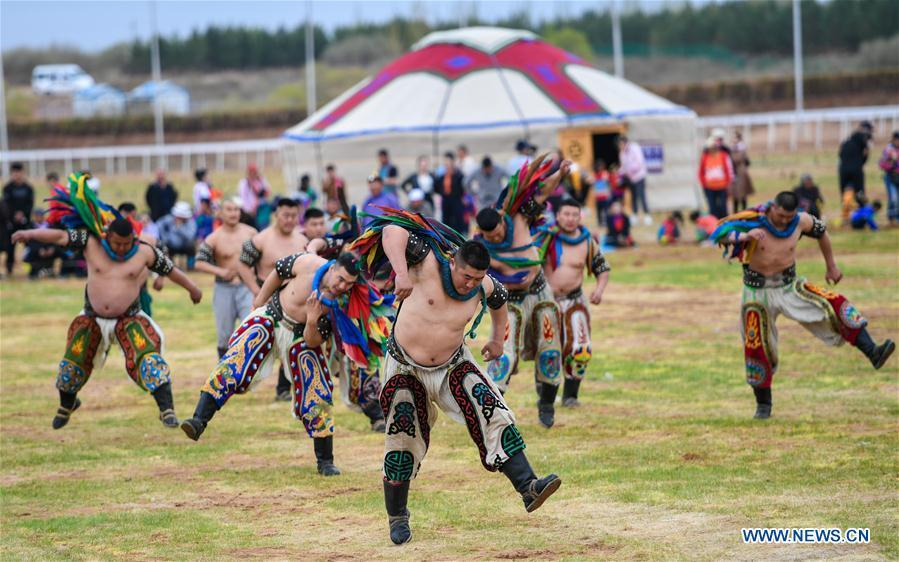 Wrestling competitors are seen at the Genghis Khan Chagan Suluk Nadam Fair in Ejin Horo Banner of Ordos City, north China\'s Inner Mongolia Autonomous Region, April 24, 2019. The two-day fair kicked off on Wednesday, including a variety of traditional activities. (Xinhua/Peng Yuan)