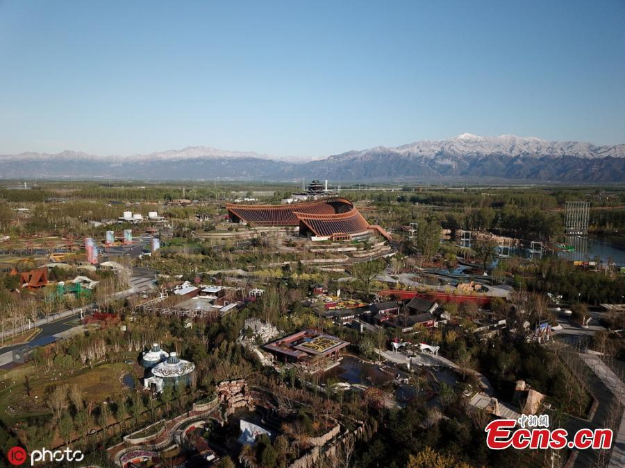 A view of the venue for the Beijing International Horticultural Exhibition against the backdrop of snow-capped mountains in Yanqing district, on the northern outskirts of Beijing, April 25, 2019. All the preparation work, including construction of the site and exhibits, has been completed as the April 29 official opening of the expo draws near, according to the organizer. (Photo/IC)