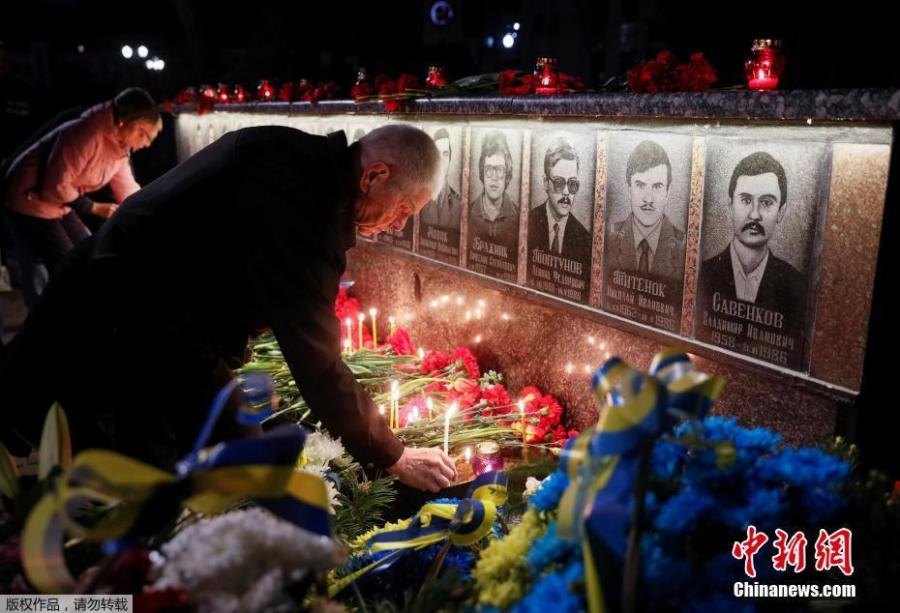 Ukrainians lay flowers at the memorial for \'liquidators\' who died during the cleaning up after the Chernobyl nuclear power plant disaster during a ceremony in Slavutich city, Ukraine, early April 26, 2019. In the early hours of April 26, 1986 the Unit 4 reactor at the Chernobyl power station blew apart. Facing nuclear disaster on unprecedented scale Soviet authorities tried to contain the situation by sending thousands of ill-equipped men into a radioactive maelstrom. The explosion of Unit 4 of the Chernobyl nuclear power plant is still regarded the biggest nuclear accident in the history of nuclear power generation.