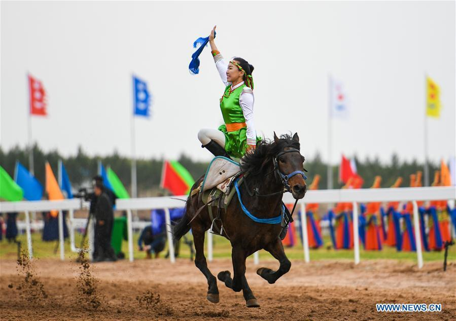A woman performs horse riding at the Genghis Khan Chagan Suluk Nadam Fair in Ejin Horo Banner of Ordos City, north China\'s Inner Mongolia Autonomous Region, April 24, 2019. The two-day fair kicked off on Wednesday, including a variety of traditional activities. (Xinhua/Peng Yuan)