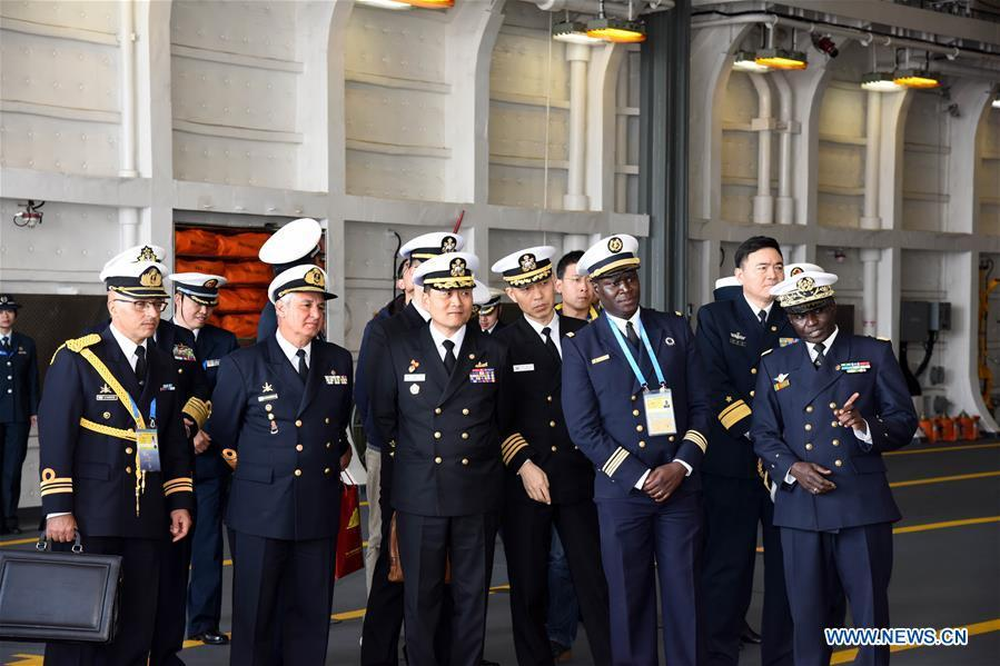 Foreign delegates visit the landing vessel Jinggangshan of the Chinese People\'s Liberation Army (PLA) Navy in Qingdao, east China\'s Shandong Province, April 25, 2019. Foreign delegations invited to participate in the multinational naval events marking the 70th anniversary of the founding of the Chinese PLA Navy visited Chinese vessels and communicated with Chinese soldiers and officers on Thursday. (Xinhua/Li Ziheng)