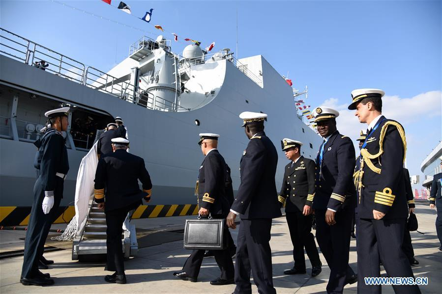 Foreign delegates prepare to visit the landing vessel Jinggangshan of the Chinese People\'s Liberation Army (PLA) Navy in Qingdao, east China\'s Shandong Province, April 25, 2019. Foreign delegations invited to participate in the multinational naval events marking the 70th anniversary of the founding of the Chinese PLA Navy visited Chinese vessels and communicated with Chinese soldiers and officers on Thursday. (Xinhua/Li Ziheng)