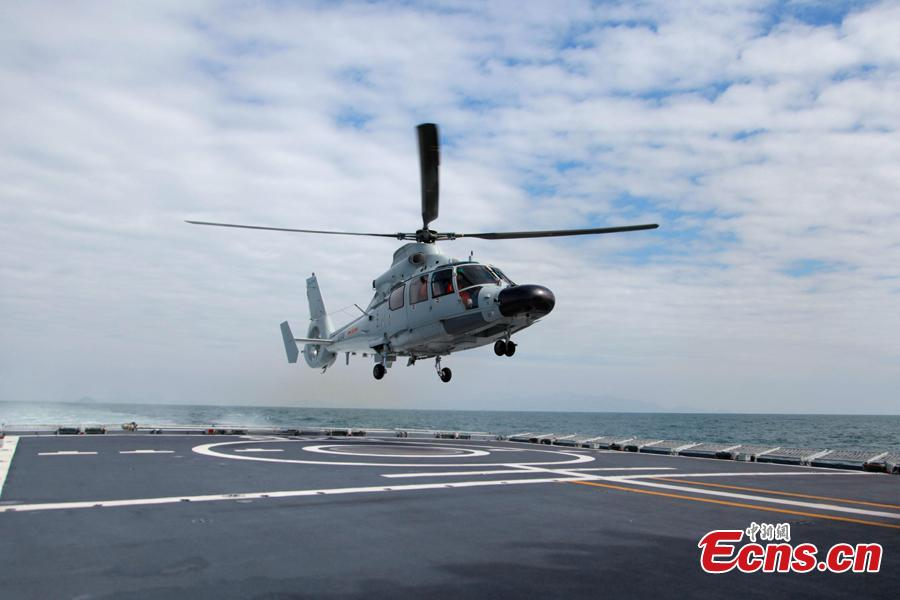 A helicopter takes off from a Chinese naval vessel during a joint naval exercise on the sea off Qingdao, east China\'s Shandong Province, on April 26, 2019. China conducted a joint naval exercise with Southeast Asian countries in Qingdao, with focus on jointly handling maritime emergency rescues. (Photo: China News Service/Li Chun)