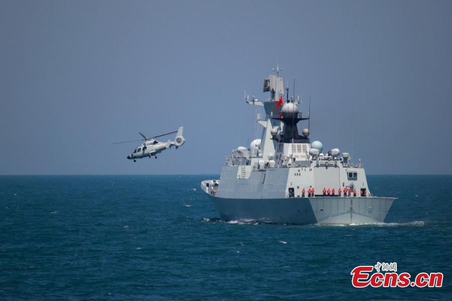 A helicopter takes off from a Chinese naval vessel during a joint naval exercise on the sea off Qingdao, east China\'s Shandong Province, April 26, 2019. China conducted a joint naval exercise with Southeast Asian countries in Qingdao, with focus on jointly handling maritime emergency rescues. (Photo: China News Service/Li Chun)