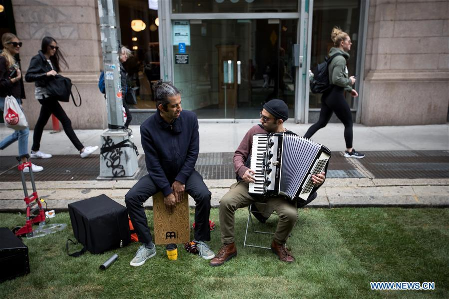 Musicians perform on a grass-covered patch of Broadway during the Car Free Earth Day 2019 in New York, the United States, April 27, 2019. The annual event was created to help raise awareness about environmentally friendly ways to get around town. (Xinhua/Michael Nagle)