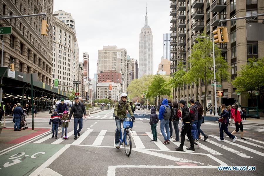 Pedestrians and a cyclist move down Broadway during the Car Free Earth Day 2019 in New York, the United States, April 27, 2019. The annual event was created to help raise awareness about environmentally friendly ways to get around town. (Xinhua/Michael Nagle)