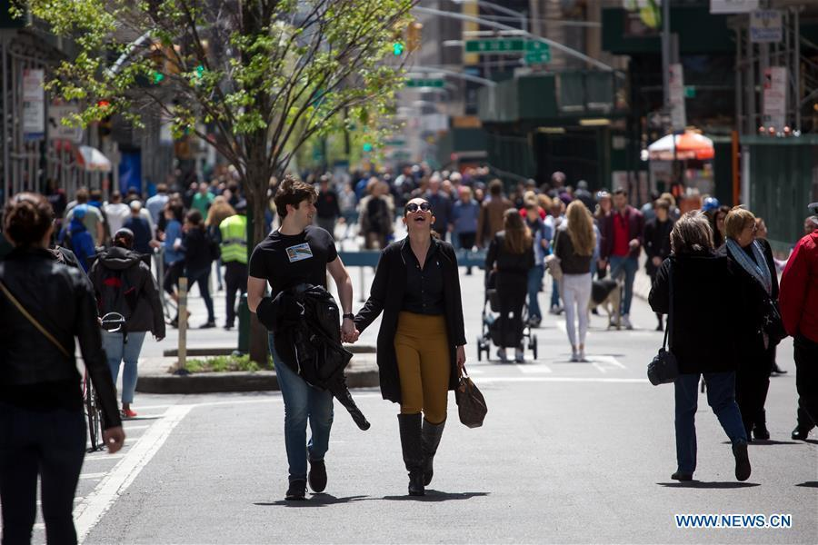 People walk on Broadway during the Car Free Earth Day 2019 in New York, the United States, April 27, 2019. The annual event was created to help raise awareness about environmentally friendly ways to get around town. (Xinhua/Michael Nagle)