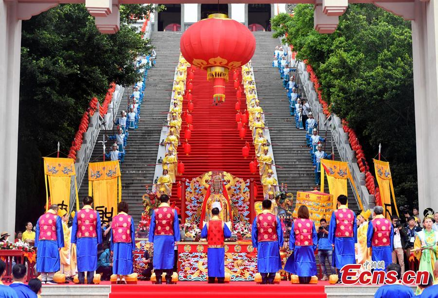 Thousands of people gather for a grand worship ceremony marking the 1,059th birthday of sea goddess Mazu on Meizhou Island in Putian City, East China\'s Fujian Province, April 27, 2019. Mazu is the deified form of Lin Mo, a shaman who lived in the 10th century on Meizhou Island. Revered after her death as a patron of seafarers, including fishermen and sailors, her worship spread throughout China\'s coastal regions and Chinese communities throughout Southeast Asia.  (Photo: China News Service/Lyu Ming)
