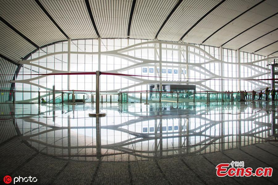 Photo taken on April 26, 2019 shows a view of the inside of the Beijing Daxing International Airport, which will begin operations before the end of September. The new airport sits at the junction of Beijing\'s southern Daxing District and Langfang, a city in Hebei Province. It is expected to handle 45 million passengers annually by 2021 and 72 million by 2025. (Photo/IC)