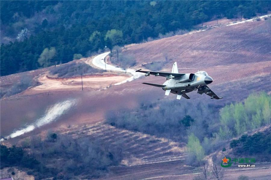 A PLA Air Force warplane in an ultra-low altitude flight training in a valley, April 25, 2019. (Photo/81.cn)