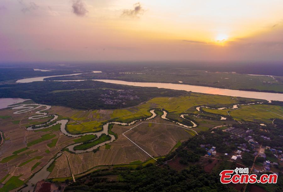 Aerial view shows the Sanshiliuquxi (36-bend stream) wetland in Yunlong Town, Haikou City, Hainan Province, April 28, 2019. Known for its rich flora and fauna as well as river bends, the wetland park will cover an area of 316.7 hectares, according to plans. (Photo: China News Service/Luo Yunfei)