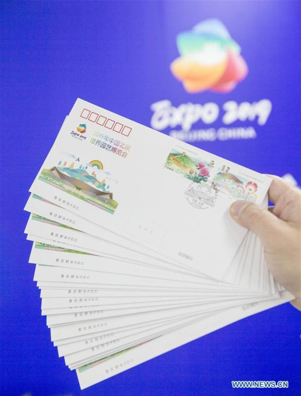 The first-day covers with commemorative stamps to mark the International Horticultural Exhibition 2019 Beijing are pictured at the media center in Yanqing District of Beijing, capital of China, April 29, 2019. Beijing Stamp Company issued the first-day cover with a set of two commemorative stamps on Monday. (Xinhua/Hou Dongtao)