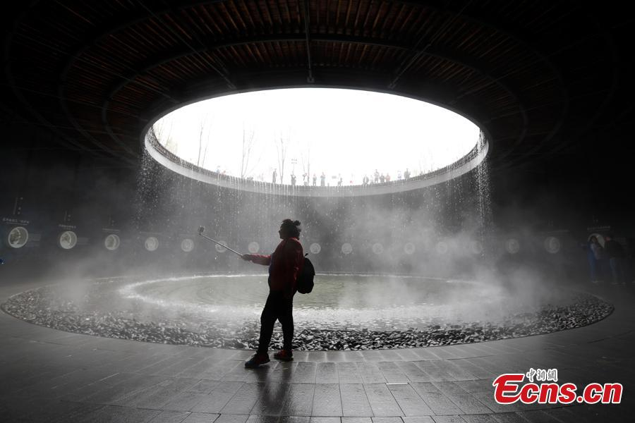 People visit the China Pavilion during the 2019 Beijing International Horticultural Exhibition in Yanqing District of Beijing, China, April 29, 2019. At the center of the expo site stands the Chinese Pavilion, a curved exhibition hall in the shape of a \