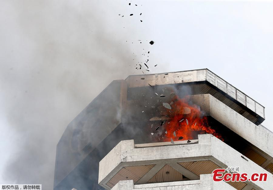 Fire burns in the top floors of a 21-story Pacific Coastal Plaza condominium in Manila, Philippines, April 29, 2019. Officials say more than 100 firetrucks converged Monday to battle the blaze that hit the Pacific Coast Plaza condominium in the Paranaque city area of Manila, where one lane of a coastal road along Manila Bay was closed due to falling debris.  A woman died in the accident. (Photo/Agencies)