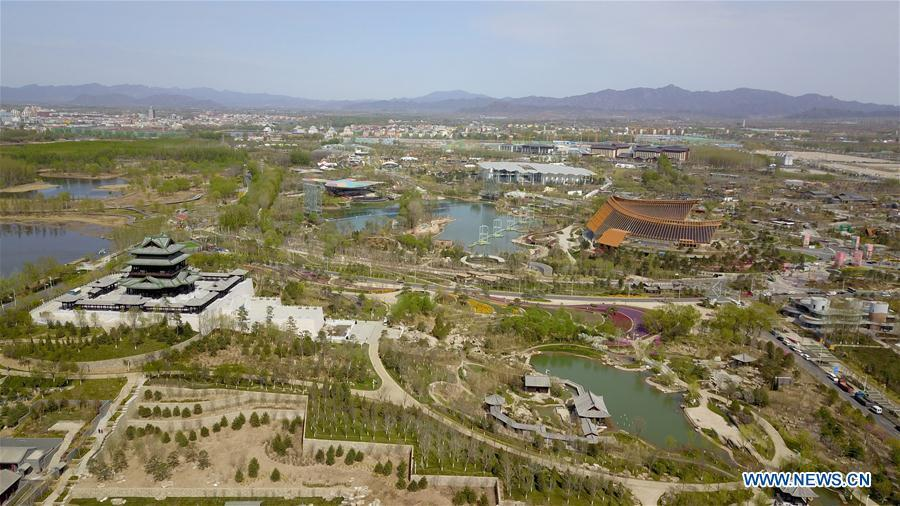 Aerial photo taken on April 18, 2019 shows the site of the International Horticultural Exhibition 2019 Beijing in Yanqing District of Beijing, capital of China. The International Horticultural Exhibition 2019 Beijing, the largest expo of its kind in the world, opened to the public Monday in Yanqing District. Yanqing boasts itself as being home to parts of the Great Wall. It is a summer resort and the agricultural base of Beijing. The upgrading of infrastructure and the acceleration of the horticulture industry because of the expo can further stimulate the development of tourism in Yanqing. (Xinhua/Chen Yehua)