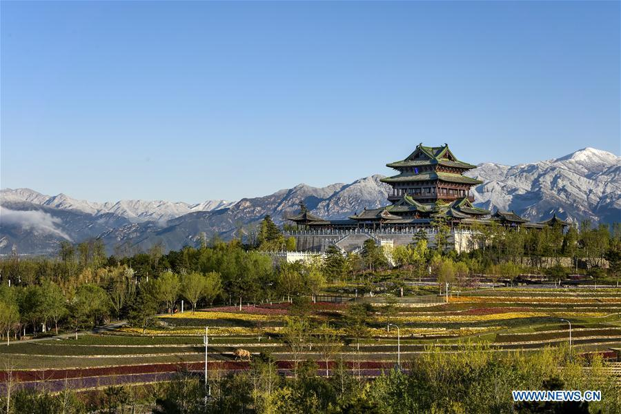 Photo taken on April 25, 2019 shows the Yongning Pavilion at the International Horticultural Exhibition 2019 Beijing in Yanqing District of Beijing, capital of China. The International Horticultural Exhibition 2019 Beijing, the largest expo of its kind in the world, opened to the public Monday in Yanqing District. Yanqing boasts itself as being home to parts of the Great Wall. It is a summer resort and the agricultural base of Beijing. The upgrading of infrastructure and the acceleration of the horticulture industry because of the expo can further stimulate the development of tourism in Yanqing. (Xinhua/Liu Guifu)