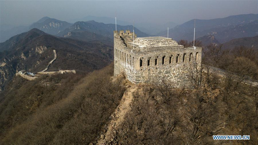 Aerial photo taken on March 18, 2019 shows Jiuyanlou Great Wall in Yanqing District of Beijing, capital of China. The International Horticultural Exhibition 2019 Beijing, the largest expo of its kind in the world, opened to the public Monday in Yanqing District. Yanqing boasts itself as being home to parts of the Great Wall. It is a summer resort and the agricultural base of Beijing. The upgrading of infrastructure and the acceleration of the horticulture industry because of the expo can further stimulate the development of tourism in Yanqing. (Xinhua/Ju Huanzong)