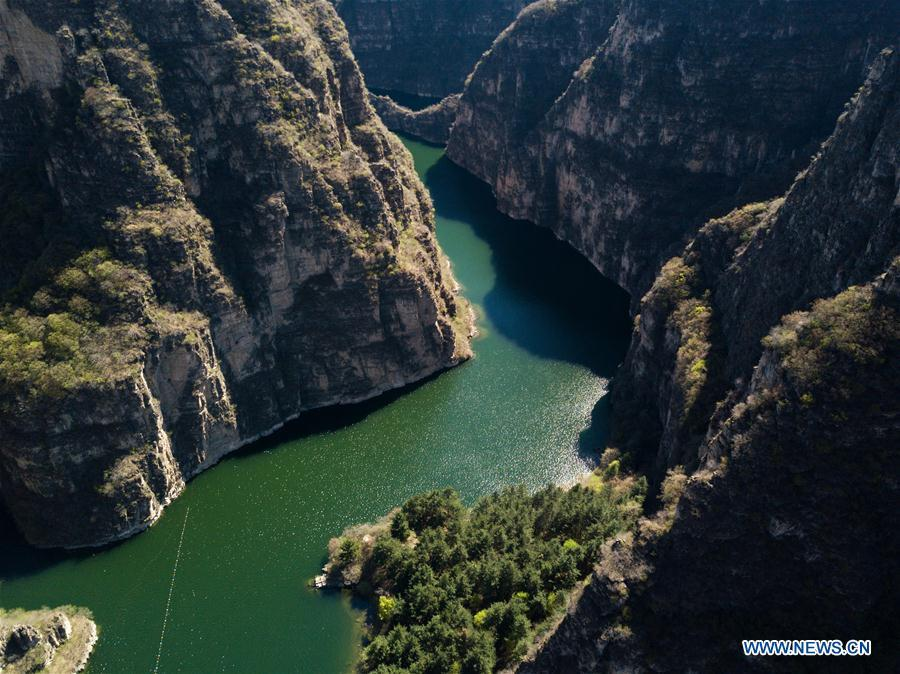 Aerial photo taken on April 30, 2019 shows the scenery of Longqing Gorge in Yanqing District of Beijing, capital of China. The International Horticultural Exhibition 2019 Beijing, the largest expo of its kind in the world, opened to the public Monday in Yanqing District. Yanqing boasts itself as being home to parts of the Great Wall. It is a summer resort and the agricultural base of Beijing. The upgrading of infrastructure and the acceleration of the horticulture industry because of the expo can further stimulate the development of tourism in Yanqing. (Xinhua/Ju Huanzong)
