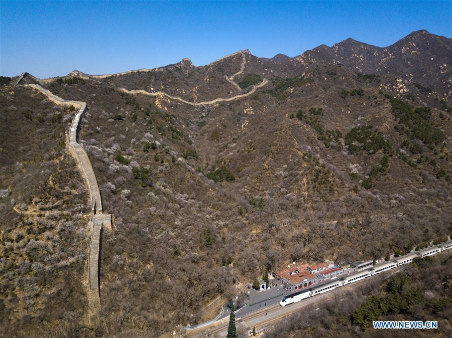 Aerial photo taken on April 2, 2019 shows the Qinglongqiao Railway Station at the foot of the Badaling section of the Great Wall in Yanqing District of Beijing, capital of China. The International Horticultural Exhibition 2019 Beijing, the largest expo of its kind in the world, opened to the public Monday in Yanqing District. Yanqing boasts itself as being home to parts of the Great Wall. It is a summer resort and the agricultural base of Beijing. The upgrading of infrastructure and the acceleration of the horticulture industry because of the expo can further stimulate the development of tourism in Yanqing. (Xinhua/Ju Huanzong)