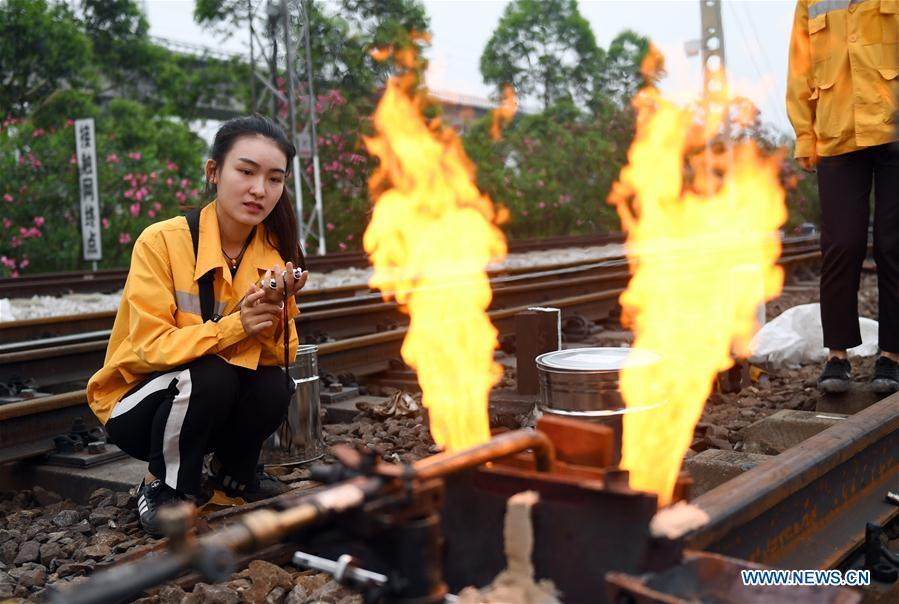 Gui Rubin, a railway worker born in 1993, is seen at a rail-change site near the Jinjicun Station in Nanning, south China\'s Guangxi Zhuang Autonomous Region, April 26, 2017. Gui is among eight female workers at a rail change and repair workshop of the Liuzhou section of Nanning Railway Bureau. They are responsible for changing and welding worn-out rails and turnouts along the railway line of thousands of kilometers under the jurisdiction of Nanning Railway Bureau. A nation will prosper only when its young people thrive; a country will be full of hope and have a great tomorrow only when its younger generations have ideals, ability, and a strong sense of responsibility. Young people always play a vanguard role in realizing national rejuvenation, which is the mission of the Chinese youth in the new era. In China many young people realize the value of life through hard work. They are writing a brilliant chapter worthy of our times in their efforts to take advantage of their youthful vigor, explore life and contribute to society. (Xinhua/Lu Boan)