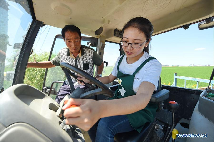 Liang Ying (R), a farm co-owner born in 1990s, drives a tractor in an organic farm at Xingde Village of Huinan County, northeast China\'s Jilin Province, July 6, 2016. After graduation in 2015, Liang gave up her high-paying job in Beijing, returned to hometown in Xingde Village and started an organic farm with her friends, as a way to boost farmers\' income. A nation will prosper only when its young people thrive; a country will be full of hope and have a great tomorrow only when its younger generations have ideals, ability, and a strong sense of responsibility. Young people always play a vanguard role in realizing national rejuvenation, which is the mission of the Chinese youth in the new era. In China many young people realize the value of life through hard work. They are writing a brilliant chapter worthy of our times in their efforts to take advantage of their youthful vigor, explore life and contribute to society. (Xinhua/Zhang Nan)