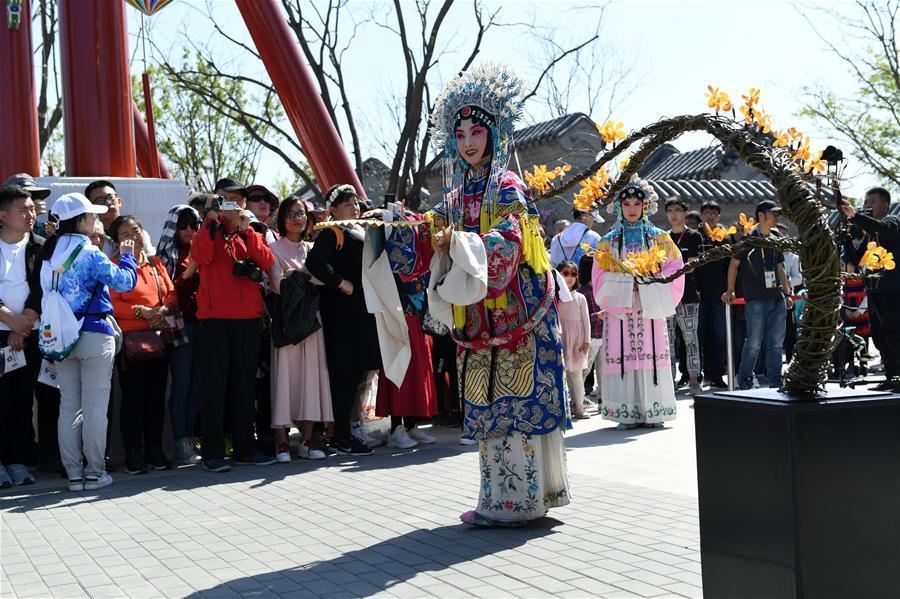 Artists perform at the Beijing Garden at the International Horticultural Exhibition 2019 Beijing in Yanqing District of Beijing, capital of China, May 1, 2019. Beijing International Horticultural Exhibition welcomed its first tourist peak by serving more than 320,000 tourists during the four-day May Day holiday, the organizer said Saturday. Some 132 activities, including float parades, world ethnic and folk cultural performances, and culture and art carnivals staged by central and eastern European countries, were held during the holiday. With the theme of \