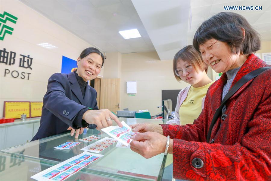 People purchase commemorative stamps for the 100 anniversary of the May 4th Movement at Handan branch office of China Post, in Handan City, north China\'s Hebei Province, May 4, 2019. China Post on Saturday issued a set of two commemorative stamps marking the 100 anniversary of the May Fourth Movement. (Xinhua/Hao Qunying)