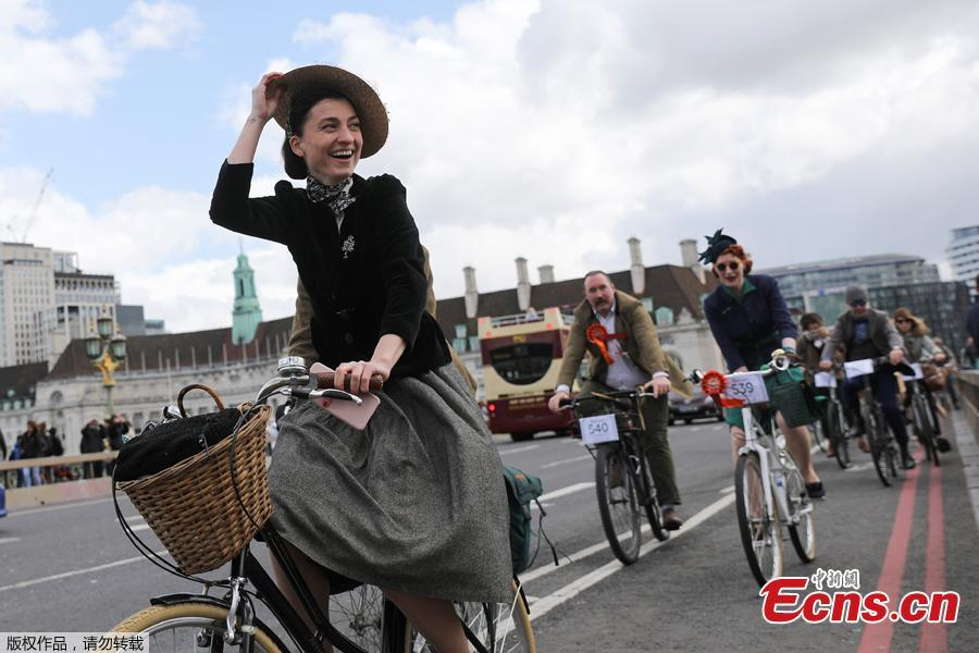Participants ride their bicycles as they take part in the annual Tweed Run across London, Britain May 4, 2019. They ride through London\'s historic streets, stopping mid way for a picnic and ending with a traditional British \