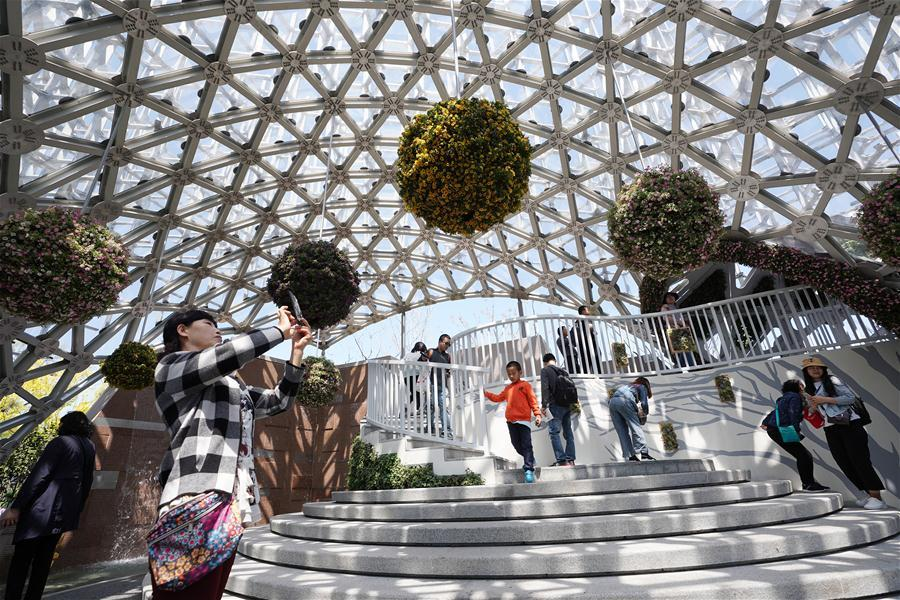 Tourists visit the Shanghai Garden of the International Horticultural Exhibition 2019 Beijing in Yanqing District of Beijing, capital of China, May 1, 2019. Beijing International Horticultural Exhibition welcomed its first tourist peak by serving more than 320,000 tourists during the four-day May Day holiday, the organizer said Saturday. Some 132 activities, including float parades, world ethnic and folk cultural performances, and culture and art carnivals staged by central and eastern European countries, were held during the holiday. With the theme of \