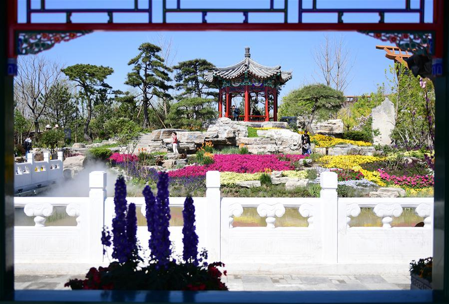 Visitors are seen at the Beijing Garden at the International Horticultural Exhibition 2019 Beijing in Yanqing District of Beijing, capital of China, May 1, 2019. Beijing International Horticultural Exhibition welcomed its first tourist peak by serving more than 320,000 tourists during the four-day May Day holiday, the organizer said Saturday. Some 132 activities, including float parades, world ethnic and folk cultural performances, and culture and art carnivals staged by central and eastern European countries, were held during the holiday. With the theme of \