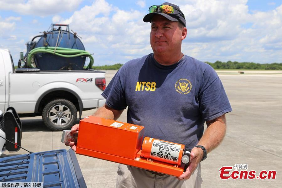 National Transportation Safety Board (NTSB) investigator Dan Boggs holds the flight data recorder recovered from the Miami Air International Boeing 737-800 that overran the runway at NAS Jacksonville and came to rest in the St Johns River in Jacksonville, Florida, U.S., May 4, 2019. (Photo/Agencies)