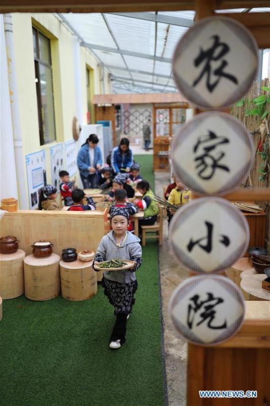 Children help make festival cuisine to mark the upcoming \