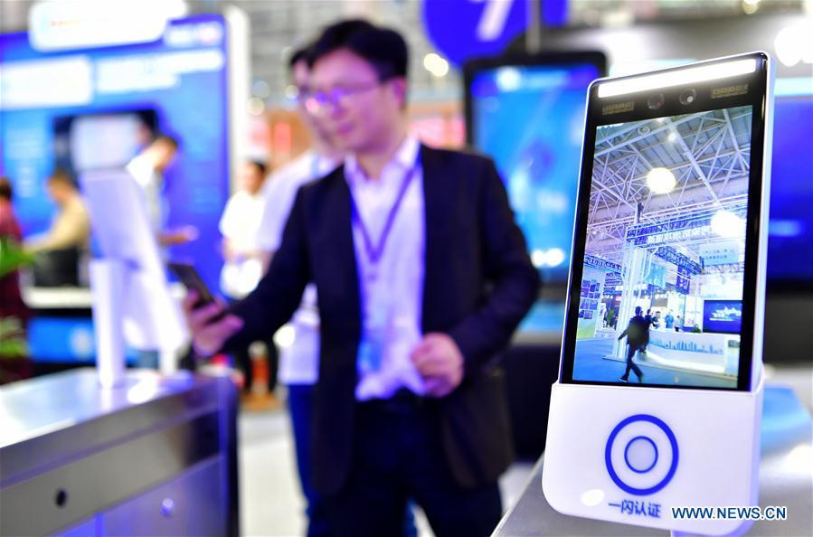 An exhibitor shows a face-detection entrance guard system at the 2nd Digital China Exhibition in Fuzhou, southeast China\'s Fujian Province, May 5, 2019. The 2nd Digital China Exhibition runs from May 5 to 9 at the Fuzhou Strait International Conference & Exhibition Center. (Xinhua/Wei Peiquan)