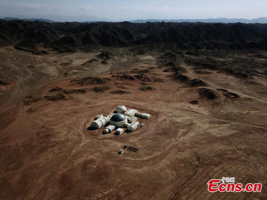 A picture taken with a drone shows an aerial view of the C-Space Project, a Mars simulation base in the Gobi Desert in Jinchang, Gansu Province, China. The C-Space Project Mars Base opened officially on 17 April 2019 with the aim to educate and provide an environment for youths and tourists to experience life on planet Mars. The base occupying an area of 11,996 square feet is situated about 40 kilometers from the town of Jinchang in the Gobi Desert. The location is chosen to simulate the landscape and harsh conditions of living on Mars as much as possible. (Photo/China News Service)